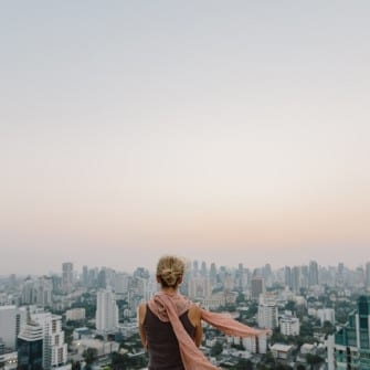 Woman looking the cityscape from the roof